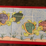Painted turtles in tray